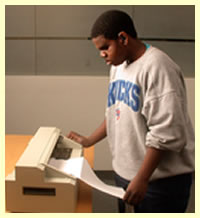 student using the braille printer