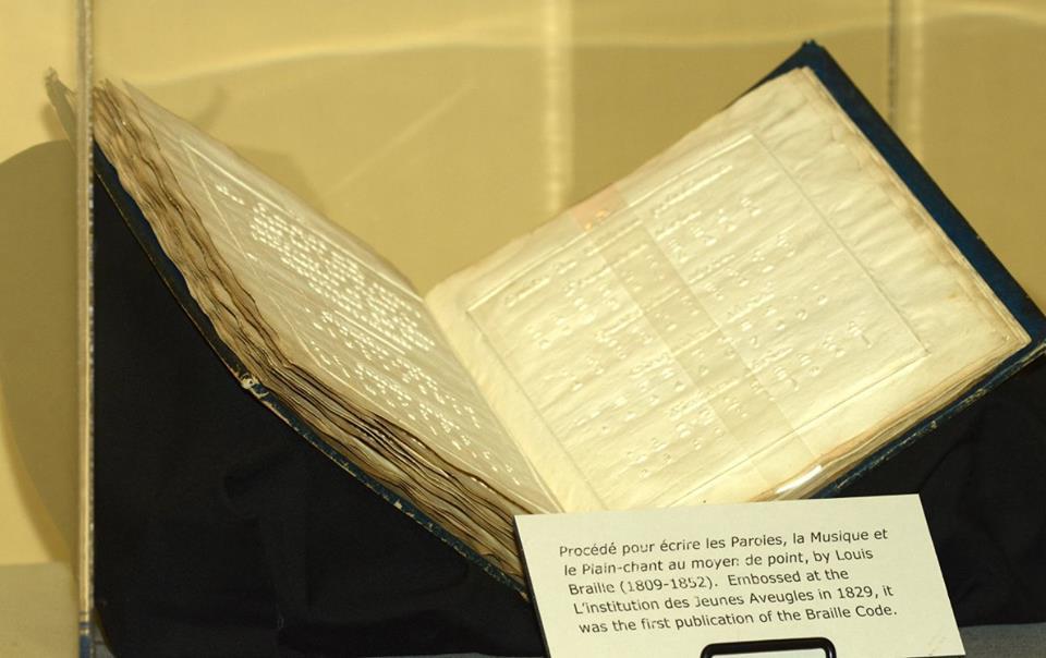 Louis Braille's book: Proc�d� pour �crire les Paroles, la Musique et le Plain-chant au moyen de point, on display in the APH Museum